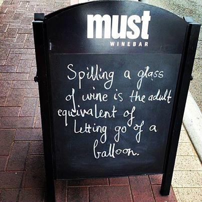 Stained glass quote Spilling a glass of wine is the adult equivalent of letting of go a balloon.